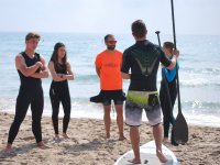 Sup lessons with students with neoprene