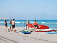 Holding the red sup board