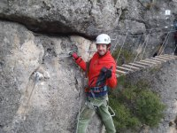 Holding with one hand in the ferrata