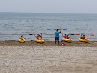 On the canoes on the shore with the instructor
