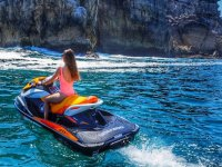Girl on the jet ski next to the cliffs of Suances