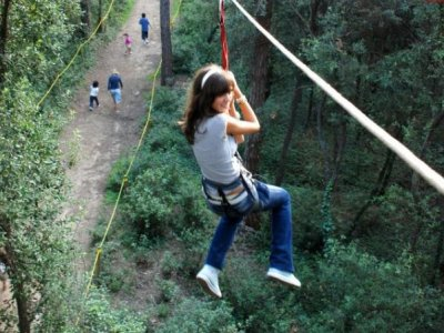 Tree top adventure park in Dosrius. 13 years old.