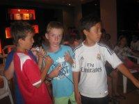 Boys doing karaoke