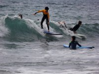 Surf class with several students