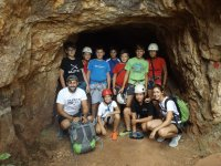 Students at the entrance of the cave