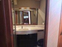 Mirror and on-board washbasin