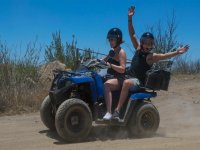 Girl and passenger on a quad
