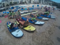 Surfing classes in the sand