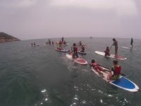 A group practicing paddle