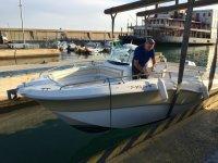 降低船到水--999-在太阳海岸的船上遮阳篷