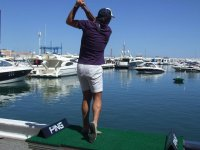 Golfer in the port of Barcelona