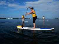 Sinking sup rowing in the sea