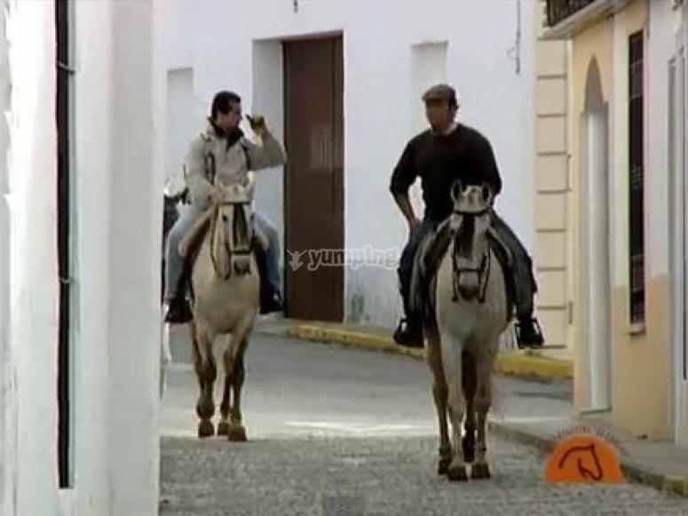 Horse riding through the town