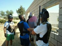 Preparing the pigeon in the paintball field
