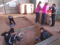 Menores buscando e la arena