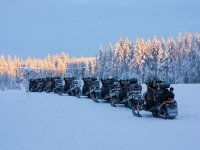 Snowmobiles parked on the trail