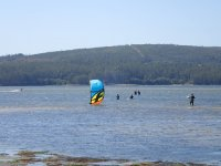 With the kite open in the water