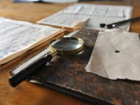 Magnifying glass and documents