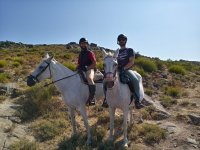 Friends riding the horse