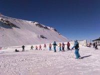 Compartiendo clase de esqui