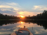 pesca kayak y puesta de sol