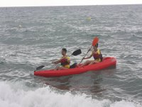 Rowing in a two-seater kayak