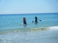 Practicing paddle surfing in Altafulla