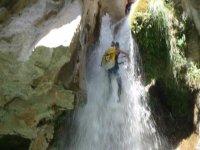 Rappelling between waterfalls