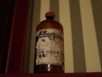 Glass bottle with worn label