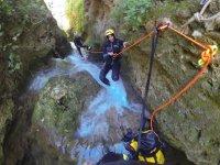 Holding the orange rope
