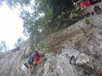 Climbing up the rock in pairs