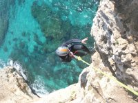 Rappelling to the cave in Mallorca