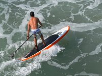 Paddling on a surfboard