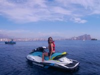 Girl riding a jet ski