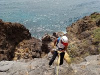 Rappelling by the sea