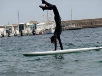 Headstand on the surfboard
