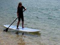 Girl learning paddle surf
