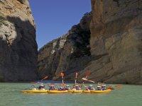 Kayak between cliffs