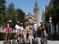 At feet of the tower in segway
