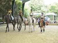 Horse riding group in the camp