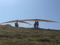 Taking off on the hang glider with the instructor
