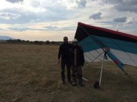 Posing with the hang glider pilot