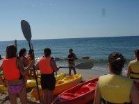 Attending the kayak expert