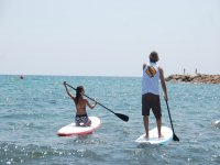 Together with the teacher in a SUP class