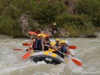 In the rafting raft with yellow helmets