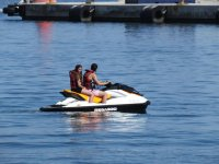 Couple in the same jet ski in Valencia