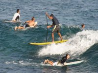 grupo de paddle surf y surf corriente