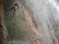 Rappel in the rain of a waterfall