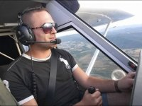 At the controls of the plane.JPG