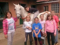 Peques taking care of the horse